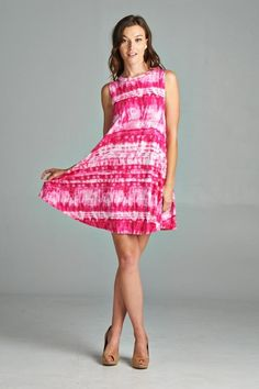 Tie-dyed print swing dress that is comfortable and soft. The pink is very bright and eye catching. Made in USA.  www.cherishusa.com www.fashiongo.net/cherish
