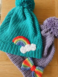 A supersoft bobble hat with a bright rainbow embellishment guaranteed to add a touch of cheer to dull and chilly winter days.