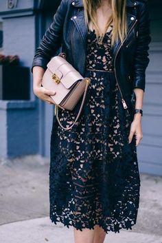 Black lace dress with moto jacket.