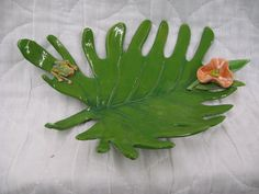 Ava Beshears.ceramic. Philodendron leaf with frog.