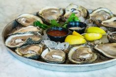 Bourbon House - Thrillist New OrleansThe Bourbon House has a more highfalutin happy hour with dollar oysters on the half shell. But it's right there in the Quarter and it's a bargain for the area. Along with oysters, enjoy $3 Abita drafts, $4 glasses of house wine, and $5 small plates of items like truffled Romano potato chips or red bean hummus