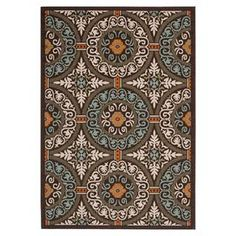 Indoor/outdoor rug with a medallion motif.  Product: RugConstruction Material: PolypropyleneColor: Chocolate and aquaFeatures:  Made in TurkeyMachine madeSuitable for indoor and outdoor use Note: Please be aware that actual colors may vary from those shown on your screen. Accent rugs may also not show the entire pattern that the corresponding area rugs have.Cleaning and Care: Sweep, vacuum or rinse off with a garden hose