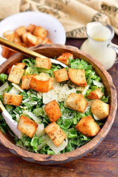 Caesar Salad is the most classic salad with distinct flavors that everyone recognizes at first bite. This Caesar salad recipe has homemade croutons and a creamy Caesar dressing that your whole family will love. #salad #caesar #dressing #croutons #homemade
