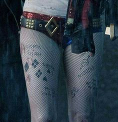 ❝They're stick and poke tattoos,prison-style when you don't have a tattoo gun.She did them out of boredom and desperation.There's an 'I Heart Puddin',a Joker face and a love heart.That's obviously reflective of her time in prison.❞ — Suicide Squad's Harley Quinn .♡.