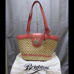 Brighton Medium Straw bag Straw picnic style bag with pink leather handle and trim.  Gorgeous floral accent on snap closure.  In excellent condition.  There is one ink mark on the inside of the snap closure. Cannot be seen when bag is closed.  Pic included.  Please see additional pics in my closet. Brighton Bags Shoulder Bags