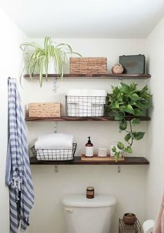 Simple shelves above the toilet with some strategically chosen storage and decor can completely transform a small bathroom.