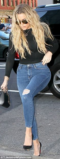 Khloe Kardashian is casual cool in black top & blue jeans during NYFW #dailymail