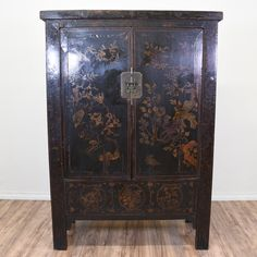 This rustic asian inspired armoire is featured in a solid wood with a distressed black lacquer wood and gold chinoiserie scenery . This wardrobe is in great condition with 2 doors, a large interior cabinet with shelving and a raised base. Eye catching storage piece perfect as a media center! #asian #dressers #armoireorwardrobe #sandiegovintage #vintagefurniture