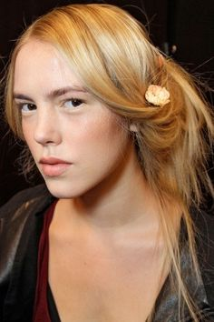 Haute Hairstyles That Rocked The 2013 Runway: There's nothing like adding a delicate bloom to your tresses to take them from messy to romantic. At Badgley Mischka, models rocked the fairy-tale princess look with undone tresses accented by single flowers. Usually having a garden in your hair would make us think of Coachella, but this look comes off more graceful and sweet than music festival.