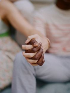 "Interracial couple holding hands. Love.  ""He felt now that he was not simply close to her, but that he did not know where he ended and she began."""
