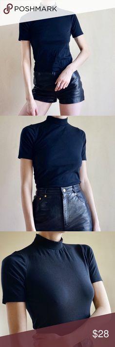 61774228e Black mock neck short sleeve tee top Black short sleeve mock neck tee from  Topshop.
