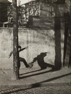 Child kicking ball, ca 1930, Andre Kertesz.(1894 - 1985)