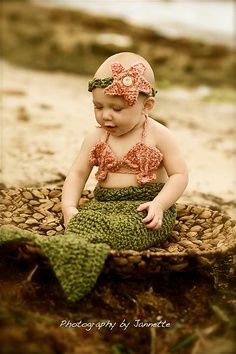 Baby mermaid! So cute (this is a baby food article, but I like the photo)