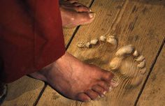 Footprints are carved into the floorboards by monk who has prayed at the same   spot for 20 years. www.telegraph.co.uk