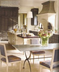 Love this French eclectic kitchen, dark wood and cream. | Beautiful Kitchens and Dining Rooms