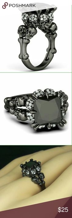 Evil love princess cut skull ring Check our feedback , our rings are hight quality and affordable prices  Excellent look in person  This is for a really unique design ring .  Skull crystals engagement ring Skulls holding a 4ct princess cut stone  This is a perfect gift idea for that special person or to yourself.  RING BASE: brass nickel free PLATING: black rhodium SIZES: 5 6 7 8 9 10 STONE CUT SIZE : princess cut 4ct in size  We guarantee your satisfaction with this unique ring  We ship…