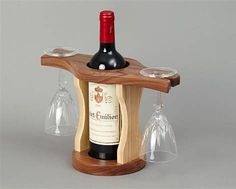 Resultado de imagem para wood wine glass holder over a wine bottle