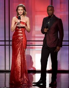 Ravishing in red: Gigi Hadid was joined by co-host Jay Pharoah as they were the main presenters of the star-studded event