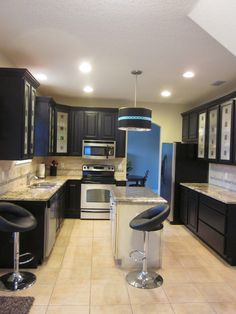 Picturesque Drums Shade Pendant Lighting Over Small Island White Granite Countertops And Modern Kitchen Black Cabinets Also Cute Black Swivel Barstools On White Ceramic Tiles Flooring Inspring Tiny Kitchen Design