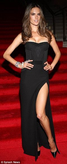 Alessandra Ambrosio shows off her perfect leg in black side split frock at Mario Testino show | Mail Online