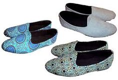 This is a closed flat shoe made from African material