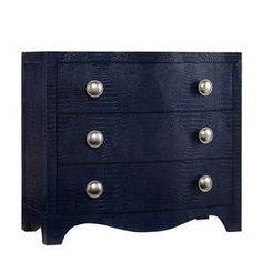 """Showcasing a blue finish and croc-inspired detailing, this chic 3-drawer chest offers handsome style and versatile storage for your home.     Product: ChestConstruction Material: Hardwood solids and leatherColor: BlueFeatures: Three drawers Dimensions: 33.75"""" H x 38"""" W x 18"""" D"""