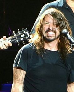 Dave Grohl-we should b e friends so we could just smile like maniacs and drive everyone crazy!!!!!