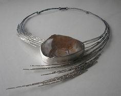 Necklace | Jolanta Bromke.  Silver (930), natural quartz with tourmaline.  Oxidation details.