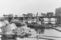 The Soviet light tanks (in the foreground) and abandoned by their crews when crossing the river, and captured by Wehrmacht soldiers. Army Chaplain, 4th Infantry Division, Ww2 Weapons, T 26, Female Marines, Tiger Tank, Tank Destroyer, Prisoners Of War, Red Army