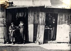 Drohobycz, Poland, Jews at the entrance to a house in the town.  Belongs to collection: Yad Vashem Photo Archive