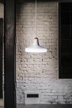 White interior - Brokis lights - Shadows are hanging lights. The designer Lucie Koldova and Dan Yeffet.