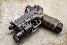 blackbeard-main: blackbeard-main: I really want to do this to a Glock You mean do the best you can to copy a HnK tac or a fnx tac 45 sorry people on gunbler I'm just not a flock kinda guy It's all good. Some people just can't handle the pe Glock Guns, Weapons Guns, Guns And Ammo, Armas Wallpaper, Shooting Guns, Custom Guns, Military Guns, Fire Powers, Cool Guns