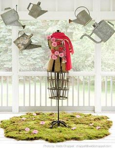 Spring 11 #retail #store #window #merchandising  ... Nice idea for garden party ( hanging watering cans)