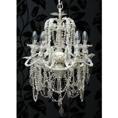 This is a really special 5-arm chandelier. It's one of the rarest chandeliers we've seen. Like a piece of vintage jewellery, it is dripping with strings of pearls, sequins, strips of woven organza, glass leaves and fairy wings around the bulbs - all in gentle shades of cream. It reminds us of the Flower Fairies, and really has to be seen!
