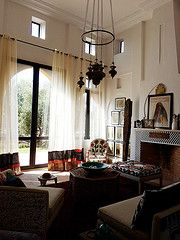 Moroccan living room. Love the light fixture. Probably something we could do. Don't you think @Kristyn Delmarto?