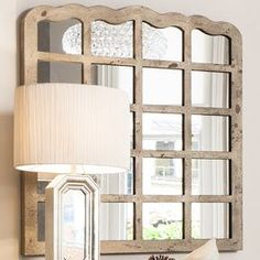 Brimming with romantically rustic appeal, this paneled window mirror completes your country living room scheme paired with a cream palette, bare wood floors and distressed accents.  Product: MirrorConstruction Material: Metal and mirrored glassColour: Natural frameDimensions: 98 cm H x 91 cm W x 4 cm D