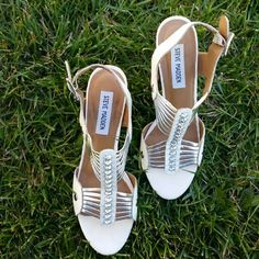 White and Silver Steve Madden Heels These white and silver Steve Madden heels would look great on you this spring! They're in very good condition!  3.75 inch heels  Price is firm. Steve Madden Shoes Heels