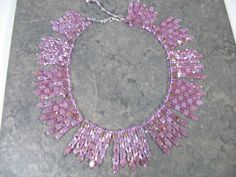 The collar in light violet hand sewn bead weaving over 1000's tiny beads