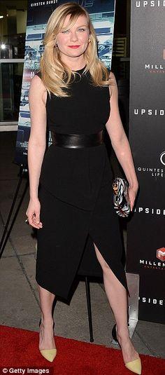 Keeping things classy: Kirsten Dunst looks sophisticated in a sleek black dress