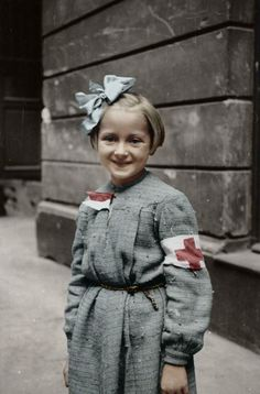 A little girl from Warsaw helping as a nurse,1944