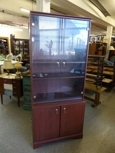 Large display cabinet with small cupboard --------------------- £45 (pc554)