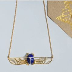 Just got a new delivery of our favourite gold necklace - In Egyptian mythology the scarab beetle symbolises rebirth renewal and protection whilst Khephera - the god of sunrise - is always connected to the cycle of life.  With Lapis lazuli and diamonds let this beautiful piece be a constant reminder of the beauty truth and reawakening each new day brings.  9 carat yellow gold set with a Lapis Lazuli and diamonds #lapislazuli #goldnecklace #zoeandmorgan #marjorelleblue