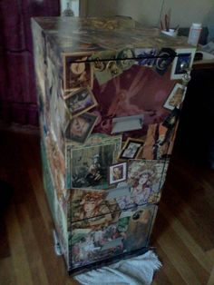 I took an old, plain, black file cabinet and mod podged pictures from old magazines, catalogs and calenders all over it.  It took about 3 days to complete.  It has between 8 and 10 coats of Mod Podge on it.