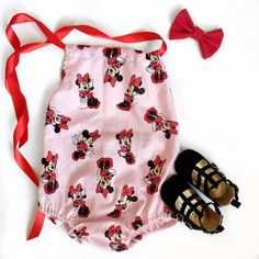 Perfect Minnie romper for your little doll Great for a first Disney visit or just when she wants to show some Minnie Love. It has a satin ribbon to tie around the neck so easily adjustable, elastic waist and leg openings make it easy for quick changes. This romper does not come with snaps at the bottom.  All Little Muse items are handmade in Southern California from a smoke free and pet free home.  Please wash in cold water on delicate or by hand and hang dry or tumble dry low for best…