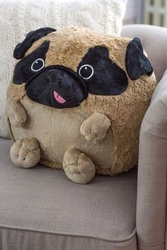 "A pug ""pillow,"" so you can masquerade as an adult with an interesting home decor taste as opposed to an adult who needs a stuffed animal."