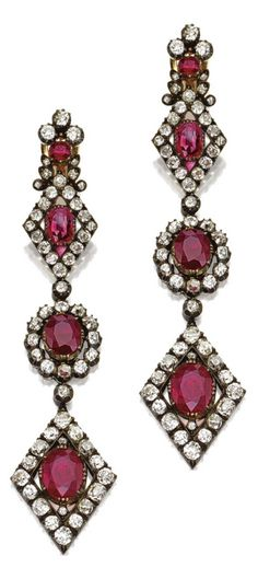 A pair of late Georgian ruby and diamond pendant-earrings, circa 1835. Designed as chains of oval and lozenge-shaped clusters suspended from quatrefoil surmounts, set with 8 cushion-shaped and round rubies and numerous cushion-shaped diamonds, mounted in gold and silver. #Georgian #antique #earrings