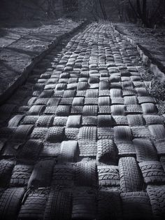 Outdoor recycled used tires sett brick road Vladivostok Russia Eco reused old - upcycling - Plantio Eco Construction, Reuse Old Tires, Reuse Recycle, Earthship Home, Tire Art, Used Tires, Brick Road, Tired, Paths