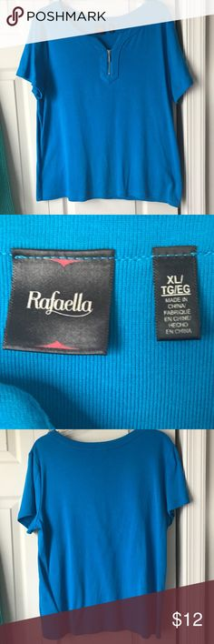 Rafaella top, more teal than blue Camera didn't quite capture the real color, which is more like a teal. 100% cotton. Decorative zipper at neckline. Worn just a few times. Great condition, hardly worn. I have the matching cardigan and may post it here but if anyone's interested, I'll speed that up. Not really a tee, but I didn't see a better category. Rafaella Tops Tees - Short Sleeve