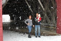Winter family picture - covered bridge in the snow fall