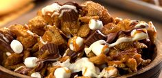 Clusters of crispy Cinnamon Chex® cereal coated with a caramelly crunch, studded with mini peanut butter cups & marshmallows, and drizzled with chocolate.